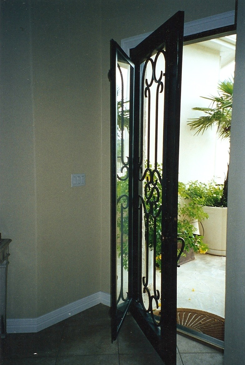 Operable glass doors build llc desai ext terrace 05 Grafton exterior wrought iron doors